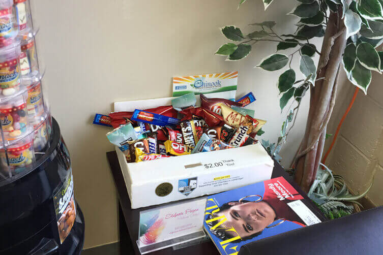 A snack box on display in a waiting area of a salon.